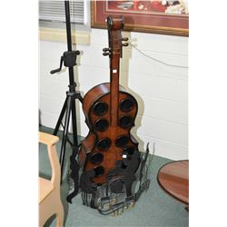 Hand crafted metal music motif fire screen and an upright bass motif wine holder