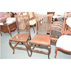 Pair of antique oak slat back side chairs with carved back supports and claw feet, appears to be ori