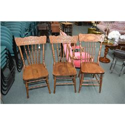 Two matching pressed back dining chair with lion motif back and a mismatched chair
