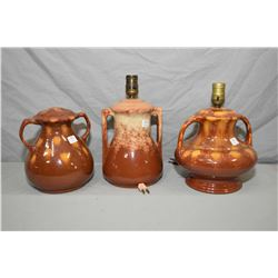 Three similar coloured Medalta glazed pottery lamps including Nos. 16, 17 and 18