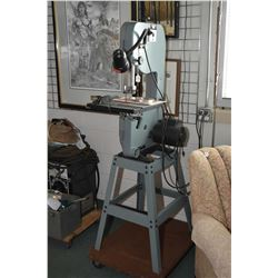 "Delta 10"" band saw, model #28-195C on metal frame with extra blade and manual, running at time of ca"