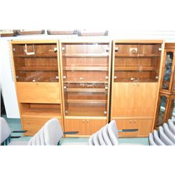 Three sections of English made mid century designed wall unit with assorted cupboards, draws and dro