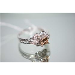 Ladies 14kt white gold and diamond ring set with center 1.00ct princess cut diamond and 0.27ct of br