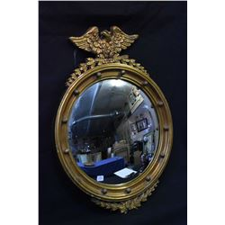 Antique gilt framed convex mirror with eagle and laurel leaf decoration