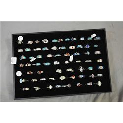 Tray of ladies brand new sterling silver rings set with lab created gemstones and opal, 63 rings in