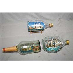 Three vintage ships in bottles