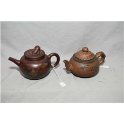 "Two purple clay tea pots one with figural finial and a ""Silent Spring"" incised pot, both purportedly"