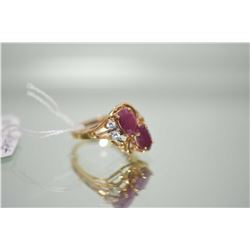 Ladies 10kt yellow gold ring set with two 0.80ct oval faceted ruby gemstones and two cubic zirconias