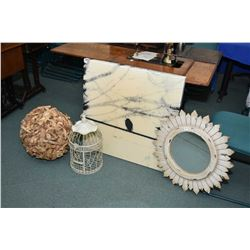 Selection of decor items including sundial mirror, birds on wire picture, bird cage, and a wood knot
