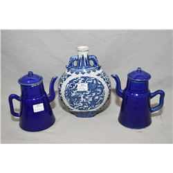 "Pair of cobalt blue tower tea pots, and a blue and white ""Dragon and Phoenix"" moon flask, early 20th"