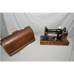 Portable hand crank Singer sewing machine in oak dome case