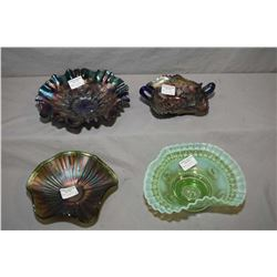 Three pieces of antique amethyst Carnival glass and a vintage green cased glass ruffled bowl