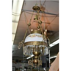 Antique brass hanging oil lamp (electrified) with a floral motif milk glass shade and hanging lustre