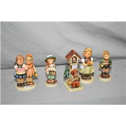 "Five Hummel/Goebel figurines including one early ""Worship"" figurine"