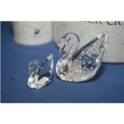 "Two Swarovski Swan including ""Centenary Swan"" 7633NR, 2"" in height plus a smaller swan, both with or"