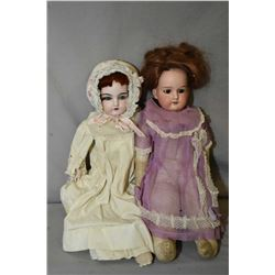 "Two antique German bisque head dolls including A.M 370 on stuffed cloth body 18"" in height and 18"" d"