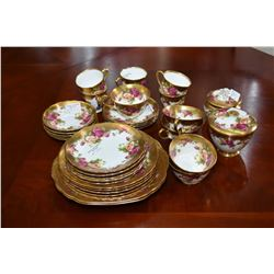 "Selection of Royal Chelsea ""Golden Rose"" table ware including six each of luncheon and bread plates,"