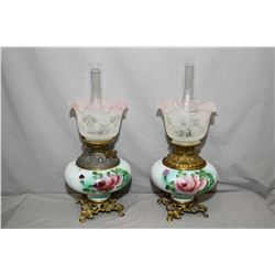 Pair of antique oil lamps with hand painted glass on cast bases, etched glass shades with chimneys,