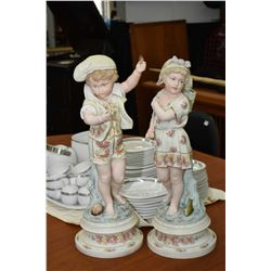 Pair of hand painted unmarked possible Heubach German bisque figurines including little boy with sea