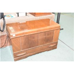 Walnut waterfall style cedar lined trunk with storage drawer made by the Honderich Furniture Company