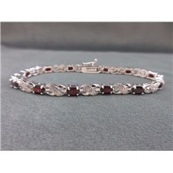 BRACELET - 6 CTW OVAL FACETED GARNET (12) & DIAMOND IN STERLING SILVER CROSS OVER DESIGNED SETTING -
