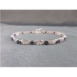 BRACELET - 7.2 CTW OVAL FACETED SAPPHIRE (12) & DIAMOND IN STERLING SILVER CROSS OVER DESIGNED SETTI