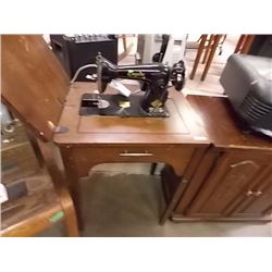 EMPIRE VINTAGE ELECTRIC SEWING MACHINE IN CABINET