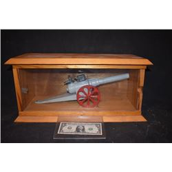 CANNON THAT ACTUALLY FIRES IN DISPLAY CASE