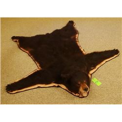 "Black Bear rug, 73""l x 67""w, w/ rings for hanging"
