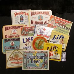 (13) Different 1940 era Lonestar, Blackhawk, Dr. Pepper, and etc. bottle labels in mint condition.