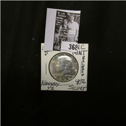 1968 D Silver Kennedy Half Dollar, Toned Brilliant Uncirculated.