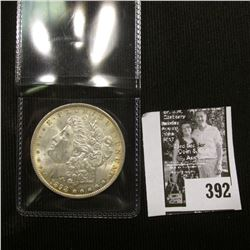 1898 P U.S. Morgan Silver Dollar, Brilliant Uncirculated with attractive Gold toning.