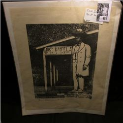 "Black and white Print of Statue of Jack Daniel, signed by artist ""1686/3000 Dan Quest RS""."