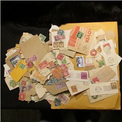 Large group of old Stamps, most of which have been removed from envelopes.