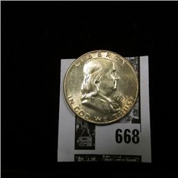 1953 D Franklin Half Dollar, lightly toned Uncirculated.
