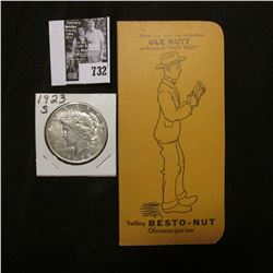 "1923 S U.S. Peace Silver Dollar, EF; & a booklet ""Have you met our salesman Ole Nutt nicknamed ""Nut"