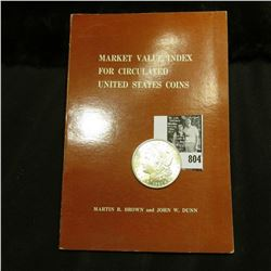 "1921 P U.S. Morgan Silver Dollar, Brilliant Uncirculated; and a book titled ""Market Value Index For"