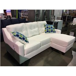 WHITE UPHOLSTERED SOFA FEATURES LOUNGER & 2 THROW CUSHIONS