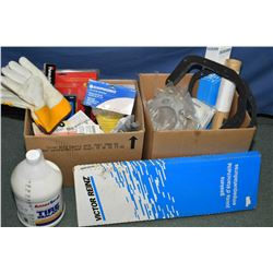Two boxes of miscellaneous shop items including gloves, gaskets, air hose, pliers, etc. and a jug of