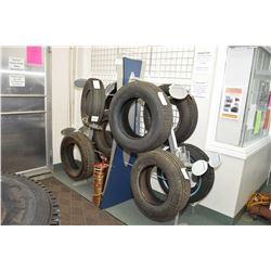 Eight station retail tire display stand- AUCTION HOUSE WILL NOT PROVIDE SHIPPING FOR THIS ITEM. BUYE