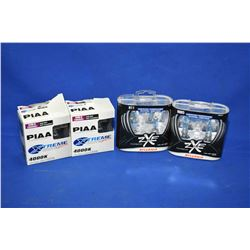 Two pair of PIAA Extreme White 9005 headlight bulbs and two pairs of Sylvania ZXE995 HID bulbs- ITEM