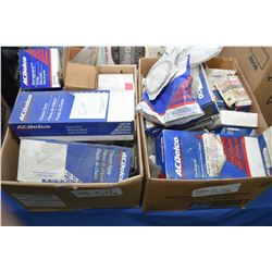 Two boxes of new inventory AC Delco parts including brakes, cooling, hardware, filters, steering etc