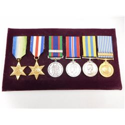 WWII ERA/KOREA WAR CANADIAN MEDALS MOUNTED ON A VELOUR BOARD