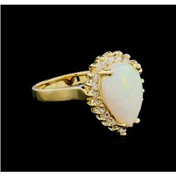 1.00 ctw Opal and Diamond Ring - 14KT Yellow Gold