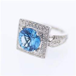 18KT White Gold 4.70ct Blue Topaz and Diamond Ring