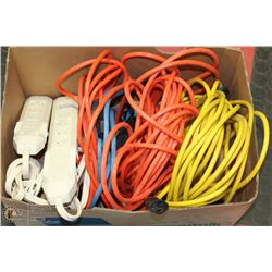 BOX OF POWER BARS AND EXTENSION CORDS