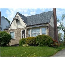 Cape Cod six room, two bedroom home, situated on a nice clean street with upscale homes.