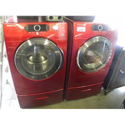 MATCHING RED SAMSUNG FRONT LOAD WASHER/DRYER WITH VRT ON MATCHING LAUNDRY PEDESTALS