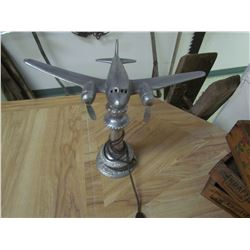 Chrome airplane on stand