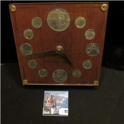 "Coin Clock, (no battery) titled ""The Silver Heritage "", contains 1883 O Silver Dollar, BU; 1964 Kenn"